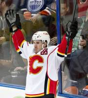 Calgary Flames' Curtis Glencross (20) celebrate a goal against the Edmonton Oilers during the second period of an NHL hockey game Saturday, March 22, 2014, in Edmonton, Alberta. (AP Photo/The Canadian Press, Jason Franson)