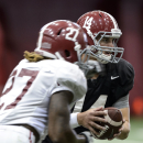 Alabama quarterback Jacob Coker (14) hands off to running back Derrick Henry (27) during NCAA college football practice, Tuesday, Sept. 2, 2014, in Tuscaloosa, Ala The Associated Press