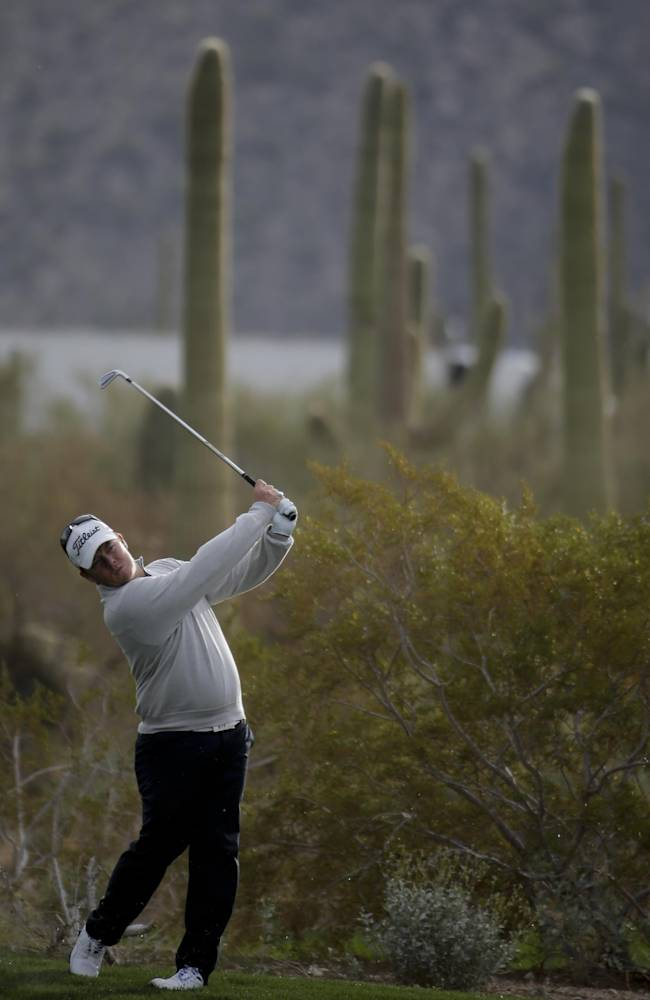 George Coetzee, of South Africa, hits to the second hole in his match against Steve Stricker during the first round of the Match Play Championship golf tournament on Wednesday, Feb. 19, 2014, in Marana, Ariz