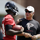 In this June 17, 2014, file photo, Atlanta Falcons head coach Mike Smith, right, talks with Devin Hester during NFL football minicamp in Flowery Branch, Ga The Associated Press