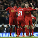 Liverpool's Jordan Henderson, right, turns as he celebrates with his teammates after scoring his teams second goal during their English Premier League soccer match between Tottenham Hotspur and Liverpool at the White Hart Lane stadium in London Sunday, De