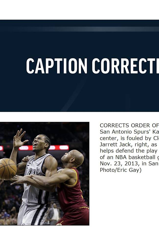 CORRECTS ORDER OF SPURS PLAYERS  - San Antonio Spurs' Kawhi Leonard, center, is fouled by Cleveland Cavaliers' Jarrett Jack, right, as Kyrie Irving, left, helps defend the play during the first half of an NBA basketball game Saturday, Nov. 23, 2013, in San Antonio