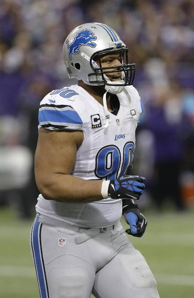 Detroit Lions defensive tackle Ndamukong Suh runs off the field during the second half of an NFL football game against the Minnesota Vikings, Sunday, Dec. 29, 2013, in Minneapolis