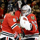 Chicago Blackhawks goalie Corey Crawford, right, smiles as he celebrates with Nick Leddy after the Blackhawks defeated the Winnipeg Jets 4-1 in an NHL hockey game in Chicago, Wednesday, Nov. 6, 2013. The Blackhawks won 4-1 The Associated Press
