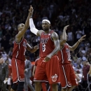 Miami Heat's LeBron James (6) high-fives teammate Chris Bosh (1) after scoring against the Portland Trail Blazers during the second half of an NBA basketball game in Miami, Tuesday, Feb. 12, 2013. The Heat won 117-104. (AP Photo/Alan Diaz)