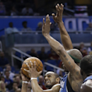 Orlando Magic's Arron Afflalo, left, looks for an open shot as he is guarded by Minnesota Timberwolves' Dante Cunningham during the second half of an NBA basketball game in Orlando, Fla., Saturday, April 5, 2014. Orlando won 100-92 The Associated Press