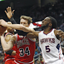 Atlanta Hawks small forward DeMarre Carroll (5) and Chicago Bulls small forward Mike Dunleavy (34) fight for a rebound in the first half of an NBA basketball game Tuesday, Feb. 25, 2014, in Atlanta The Associated Press