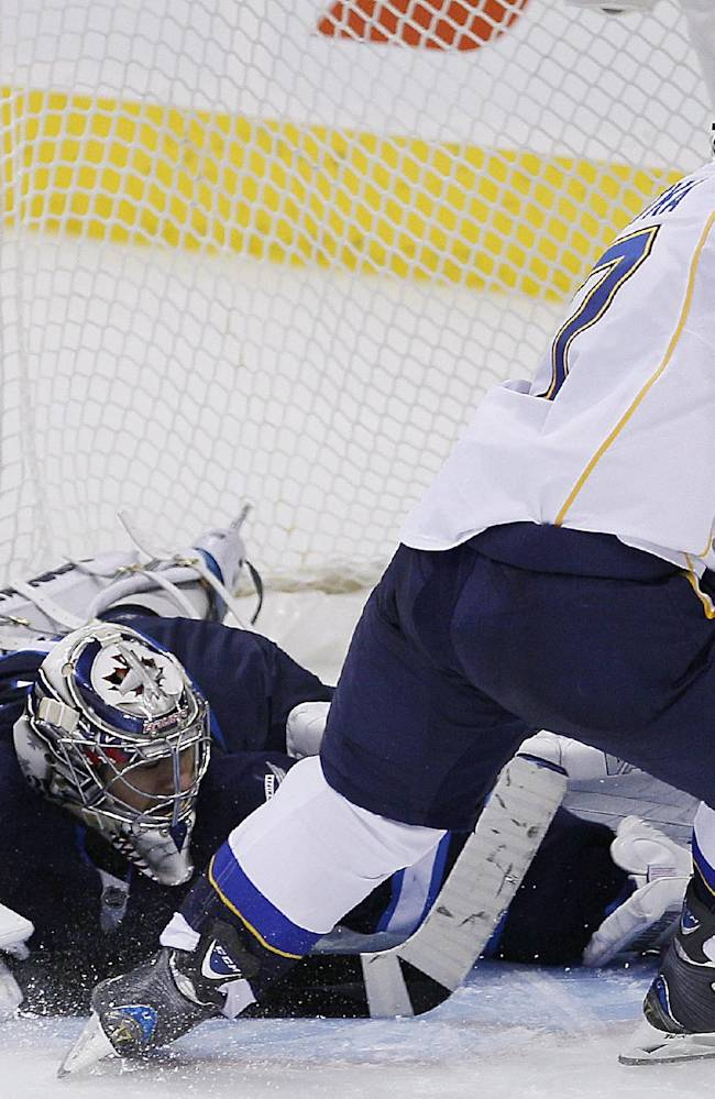Winnipeg Jets goaltender Ondrej Pavelec (31) stops the penalty shot by St. Louis Blues' Vladimir Sobotka (17) during the shoot-out in an NHL hockey game Friday, Oct. 18, 2013 in Winnipeg, Manitoba