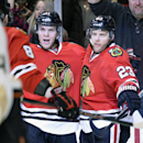 Chicago Blackhawks left wing Jeremy Morin, left, and right wing Kris Versteeg celebrate Versteeg's goal during the second period of an NHL hockey game against the Anaheim Ducks, Friday, Dec. 6, 2013, in Chicago The Associated Press