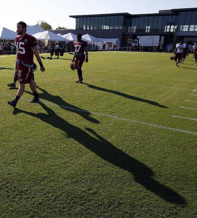 Washington Redskins linebacker Gabe Miller (45) heads out to the field for practice at the team's NFL football training facility, Friday, July 25, 2014 in Richmond, Va. (AP Photo)