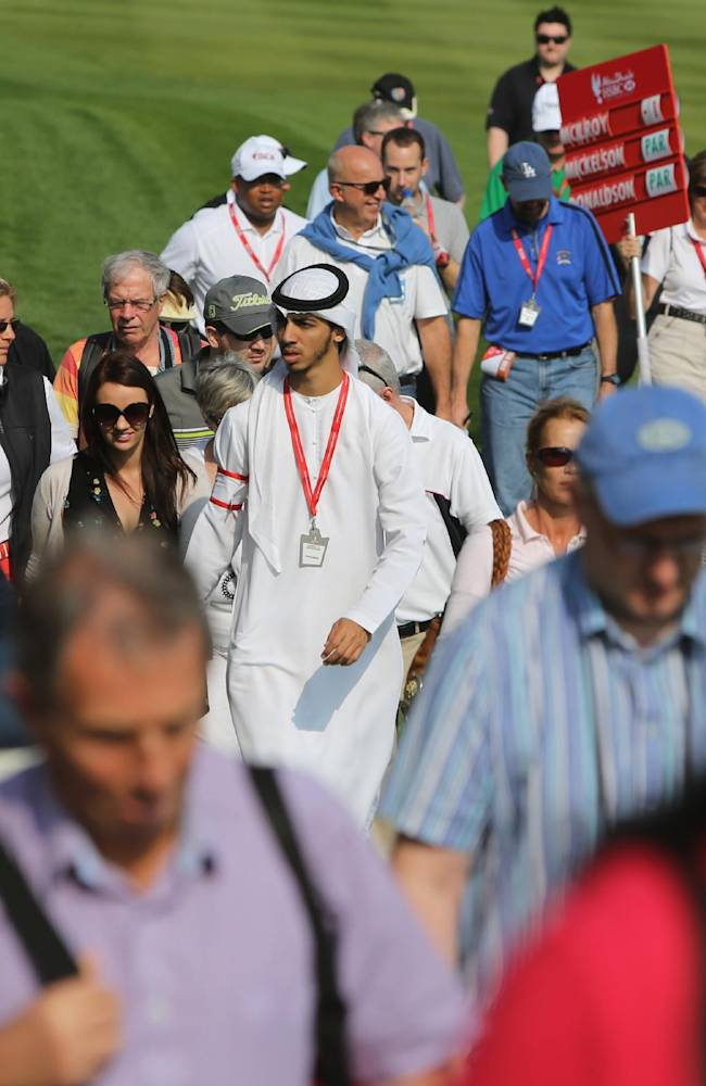 An Emirati and other fans of different nationalities attend the 1st round of the Abu Dhabi HSBC Golf Championship in Abu Dhabi, United Arab Emirates, Thursday, Jan. 16, 2014