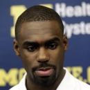 Michigan's Tim Hardaway Jr., announces he will enter the NBA draft and skip his senior basketball season during a news conference in Ann Arbor, Mich., Wednesday, April 17, 2013. (AP Photo/Paul Sancya)
