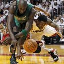 Miami Heat's Udonis Haslem and Boston Celtics' Kevin Garnett (5) go after a loose ball during the first half of Game 2 in their NBA basketball Eastern Conference finals playoffs series, Wednesday, May 30, 2012, in Miami. (AP Photo/Lynne Sladky)