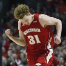 Wisconsin's Mike Bruesewitz reacts after making a three-point basket during the first half of an NCAA college basketball game against Indiana at the Big Ten tournament Saturday, March 16, 2013, in Chicago. (AP Photo/Charles Rex Arbogast)
