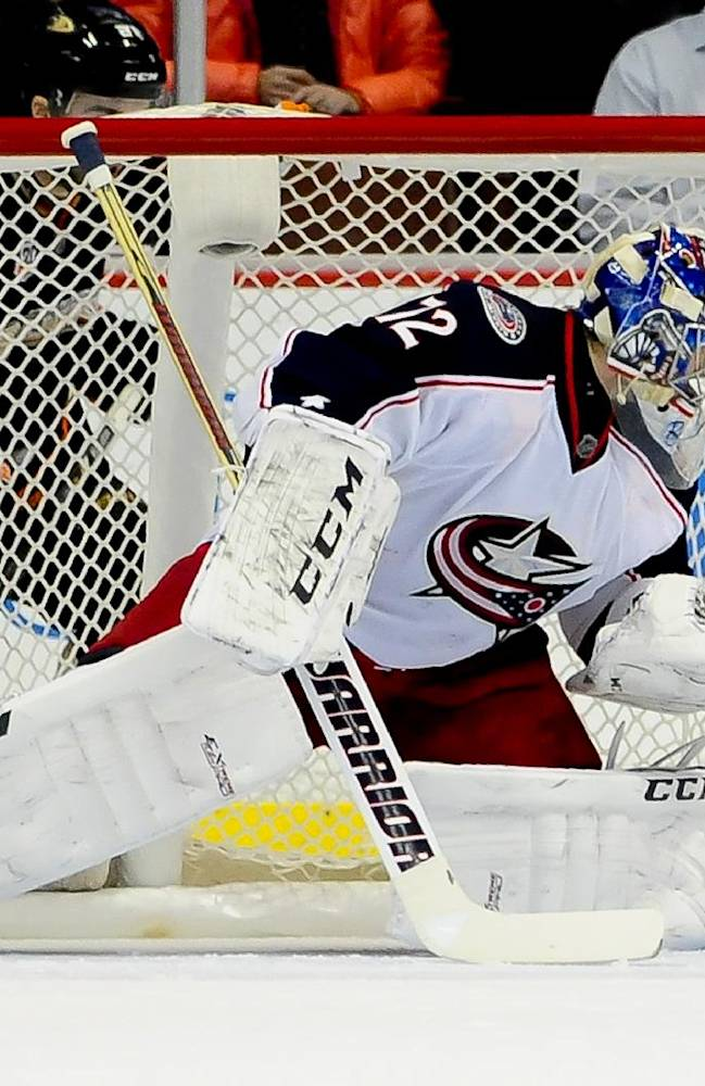 Columbus Blue Jackets goalie Sergei Bobrovsky (72), of Russia, deflects the puck during the first period of an NHL hockey game against the Anaheim Ducks, Monday, Feb. 3, 2014, in Anaheim, Calif