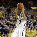 Michigan guard Trey Burke (3) shoots during the second half of an NCAA college basketball game against Purdue in Ann Arbor, Mich., Thursday, Jan. 24, 2013. Burke had 15 points and eight assists as Michigan won 68-53. (AP Photo/Carlos Osorio)