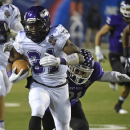 Wisconsin-Whitewater running back Dennis Moore (31) carries as Mount Union's Alex Kocheff pursues during the second half of the NCAA Division III championship college football game at Salem Stadium in Salem, Va., Friday, Dec. 19, 2014 The Associated Press