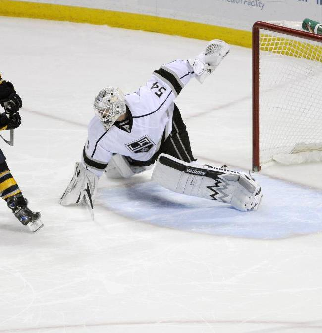 Buffalo Sabres' Matt Moulson, left, scores in the shootout past Los Angeles Kings goaltender Ben Scrivens, right, during an NHL hockey game in Buffalo, N.Y., Tuesday, Nov. 12, 2013.  Buffalo won 3-2
