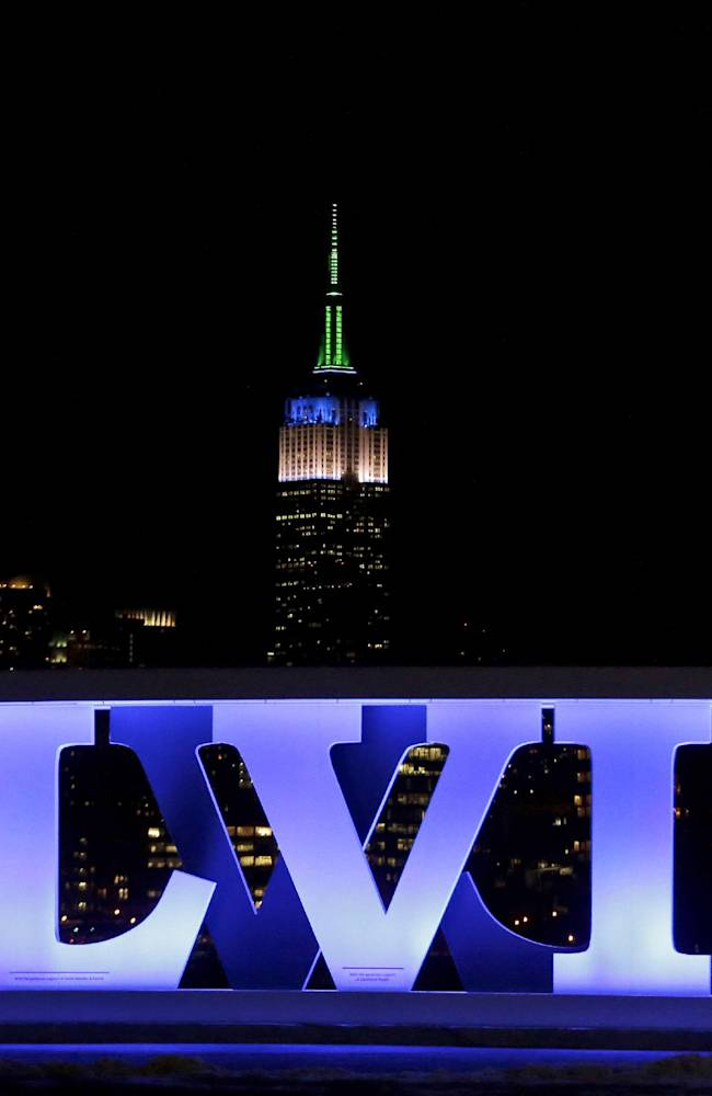 A sign for NFL football's Super Bowl XLVIII stands at Pier A Park in Hoboken, N.J., Tuesday, Jan. 28, 2014, with the Empire State Building in New York in the background. The Seattle Seahawks and the Denver Broncos are scheduled to play on Sunday in East Rutherford, N.J