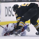 Boston Bruins defenseman Johnny Boychuk (55) throws a punch after dropping Montreal Canadiens defenseman P.K. Subban (76) to the ice during the second period of an NHL hockey game, Monday, March 24, 2014, in Boston The Associated Press