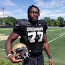 Big-hearted Cameroonian OL paves way for Colorado The Associated Press