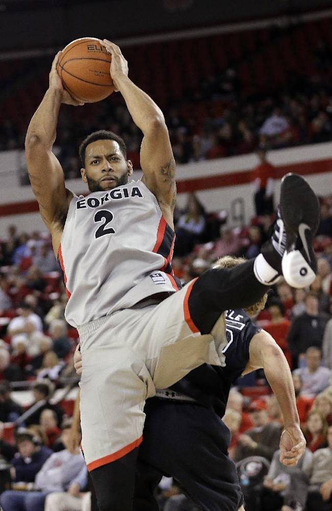 Georgia forward Marcus Thornton (2) pulls down a rebound in the second half of an NCAA college basketball game against South Carolina on Wednesday, Jan. 22, 2014, in Athens, Ga