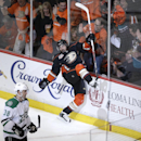 Anaheim Ducks' Mathieu Perreault, center, celebrates his goal near Dallas Stars' Vernon Fiddler during the first period in Game 1 of the first-round NHL hockey Stanley Cup playoff series on Wednesday, April 16, 2014, in Anaheim, Calif The Associated Press