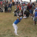 Dustin Johnson of the US plays from the rough on the 14th hole during the final round of the British Open Golf championship at the Royal Liverpool golf club, Hoylake, England, Sunday July 20, 2014