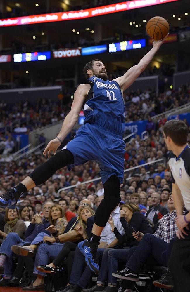 Minnesota Timberwolves forward Kevin Love leaps for a ball as it goes out of bounds during the second half of an NBA basketball game against the Los Angeles Clippers, Monday, Nov. 11, 2013, in Los Angeles. The Clippers won 109-107