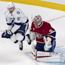 Tampa Bay Lightning's Steven Stamkos jumps to let a shot reach Montreal Canadiens goalie Carey Price during the first period of an NHL hockey game Tuesday, Jan. 6, 2015, in Montreal The Associated Press