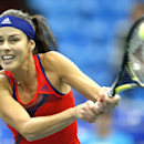 Serbia's Ana Ivanovic returns a ball to Australia's Samantha Stosur during a quarterfinal match at the Kremlin Cup tennis tournament in Moscow, Russia, Friday, Oct. 18, 2013. (AP Photo/Misha Japaridze)