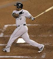 Chicago White Sox's Dayan Viciedo hits a grand slam during the fourth inning of a baseball game against the Kansas City Royals, Wednesday, Aug. 21, 2013, in Kansas City, Mo. (AP Photo/Charlie Riedel)