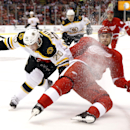 Boston Bruins left wing Daniel Paille (20) and Detroit Red Wings defenseman Brendan Smith (2) battle for the puck in the third period of an NHL hockey game in Detroit Thursday, Oct. 9, 2014 The Associated Press
