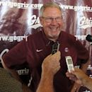 University of Montana football coach Mike Delaney speaks to reporters Thursday July 26, 2012 in Missoula, Mont. Montana is extending Delaney's contract through the 2013 season. (AP Photo/Matt Gouras)