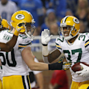 Green Bay Packers cornerback Sam Shields (37) celebrates his interception during the third quarter of an NFL football game against the Detroit Lions at Ford Field in Detroit, Thursday, Nov. 28, 2013. (AP Photo/Paul Sancya)