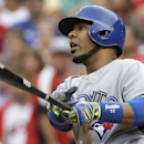 Toronto Blue Jays' Edwin Encarnacion watches his three-run home run off Cincinnati Reds starting pitcher Mat Latos in the third inning of a baseball game, Friday, June 20, 2014, in Cincinnati The Associated Press