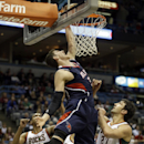 Atlanta Hawks' Mike Muscala goes up to shoot past Milwaukee Bucks' Zaza Pachulia (27) during the first half of an NBA basketball game on Wednesday, April 16, 2014, in Milwaukee The Associated Press