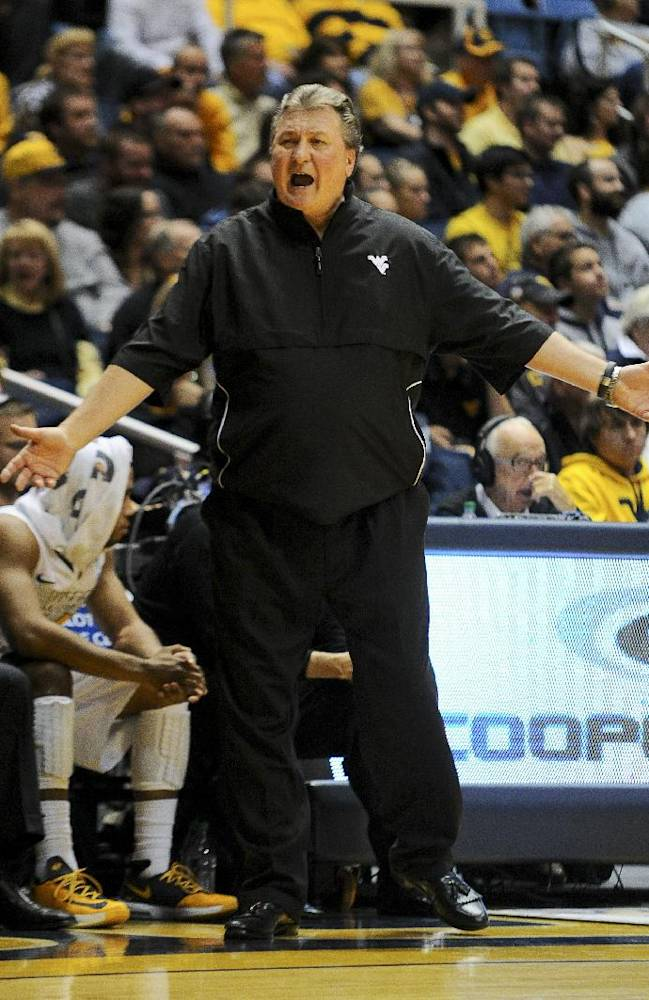 West Virginia's Bob Huggins seeks an explanation from a referee during the second half of an NCAA college basketball game against Mount St. Mary's in Morgantown, W.Va., Friday, Nov. 8, 2013. West Virginia won 77-62