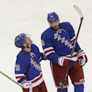 New York Rangers' Rick Nash (61) and Martin St. Louis (26) talk after Nash scored a goal during the third period of an NHL hockey game against the Buffalo Sabres on Thursday, April 10, 2014, in New York. The Rangers won 2-1 The Associated Press