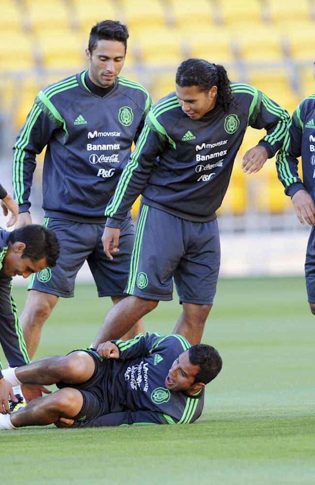 Mexico's Carlos Pena, second from right, and his teammates have light moments during the team's training for the FIFA World Cup qualifier match against New Zealand in Wellington, New Zealand, Tuesday, Nov. 19, 2013