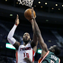 Detroit Pistons forward Greg Monroe (10) takes a shot against Milwaukee Bucks forward Ekpe Udoh (5) during the second half of an NBA basketball game Monday, March 31, 2014, in Auburn Hills, Mich. Monroe led the Pistons with 28 points and pulled down 14 re