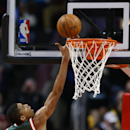 Milwaukee Bucks forward Giannis Antetokounmpo, left, goes to the basket against Chicago Bulls forward Carlos Boozer, center, during the first half of an NBA basketball game in Chicago, Friday, April 4, 2014 The Associated Press