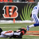 Indianapolis Colts wide receiver Da'Rick Rogers (16) runs past Cincinnati Bengals free safety Reggie Nelson on his way to a 69-yard touchdown after catching a pass in the second half of an NFL football game, Sunday, Dec. 8, 2013, in Cincinnati. (AP Photo/Tom Uhlman)
