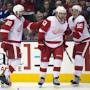 Detroit Red Wings left winger Drew Miller (20) and defenseman Danny DeKeyser (85) congratulate centrer Darren Helm (43) after he completed a hat trick against the Toronto Maple Leafs during third-period NHL hockey game action in Toronto, Saturday, March 2