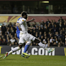 Tottenham's Emmanuel Adebayor, right, scores their third goal during the Europa League Group K soccer match between Tottenham Hotspur and Dnipro at White Hart Lane stadium in London, Thursday, Feb. 27, 2014