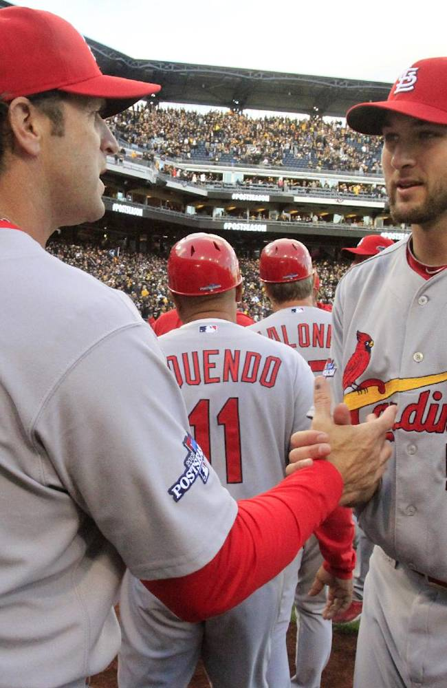St. Louis Cardinals pitcher Michael Wacha (52) is congratulated by manager Mike Matheny after the Cardinals' 2-1 win over the Pittsburgh Pirates in Game 4 of a National League baseball diviision series, Monday, Oct. 7, 2013 in  Pittsburgh
