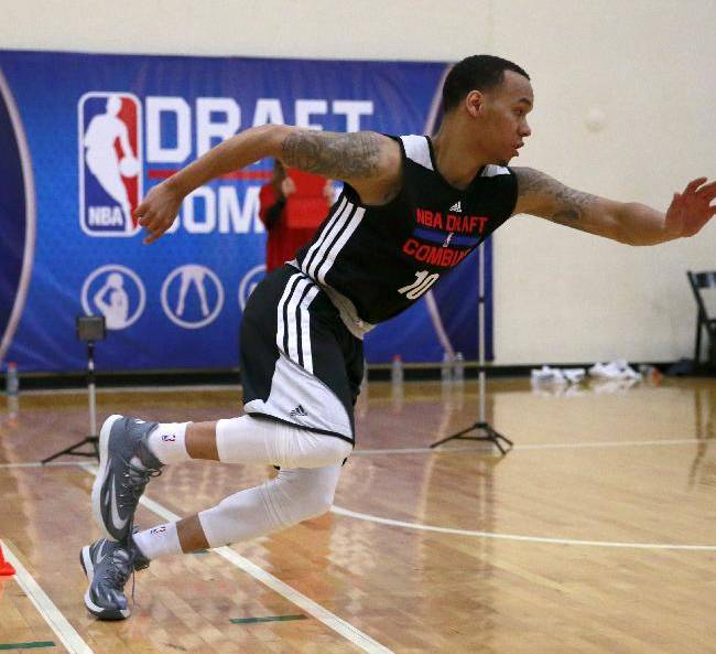 Shabazz Napier, from Connecticut, participates in NBA shuttle run at the 2014 NBA basketball draft combine Friday, May 16, 2014, in Chicago