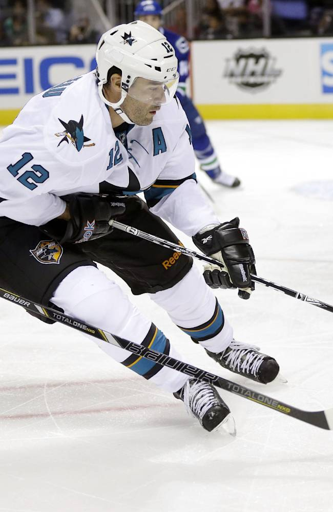 San Jose Sharks' Patrick Marleau (12) is chased by Vancouver Canucks' Henrik Sedin (33) during the second period of a preseason NHL hockey game on Tuesday, Sept. 24, 2013, in San Jose, Calif