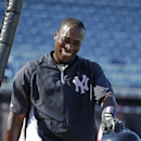 New York Yankees' Alfonso Soriano smiles while leaving the batting cage after hitting a home run over the center field wall during batting practice before the Yankee's spring exhibition baseball game against the Philadelphia Phillies in Tampa, Fla., Tuesd