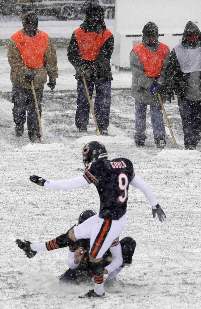 In this Dec. 12, 2010, file photo, Chicago Bears place kicker Robbie Gould (9) practices field goals as workers at Soldier Field wait to clear snow from the field before an NFL football game against the New England Patriots, in Chicago. Instead of shrinking from the possibility that football's ultimate championship could be played in a blizzard, organizers of the first outdoor, cold-climate Super Bowl, in East Rutherford, N.J., have decided to embrace the snow as the game's unofficial theme. The 197-year-old Farmers' Almanac is already out with its forecast that a big winter storm will hit the area that weekend